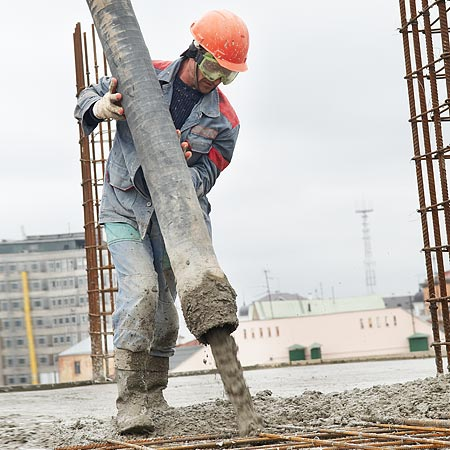 stock-photo-builder-worker-in-hard-helmet-and-uniform-during-concrete-pouring-works-at-construction-site-94326589[1]